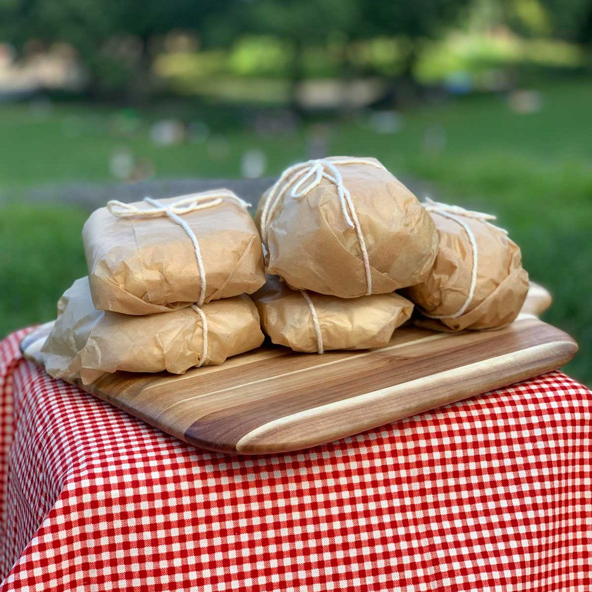 Pan Bagnat Tuna Nicoise Sandwiches wrapped for a picnic